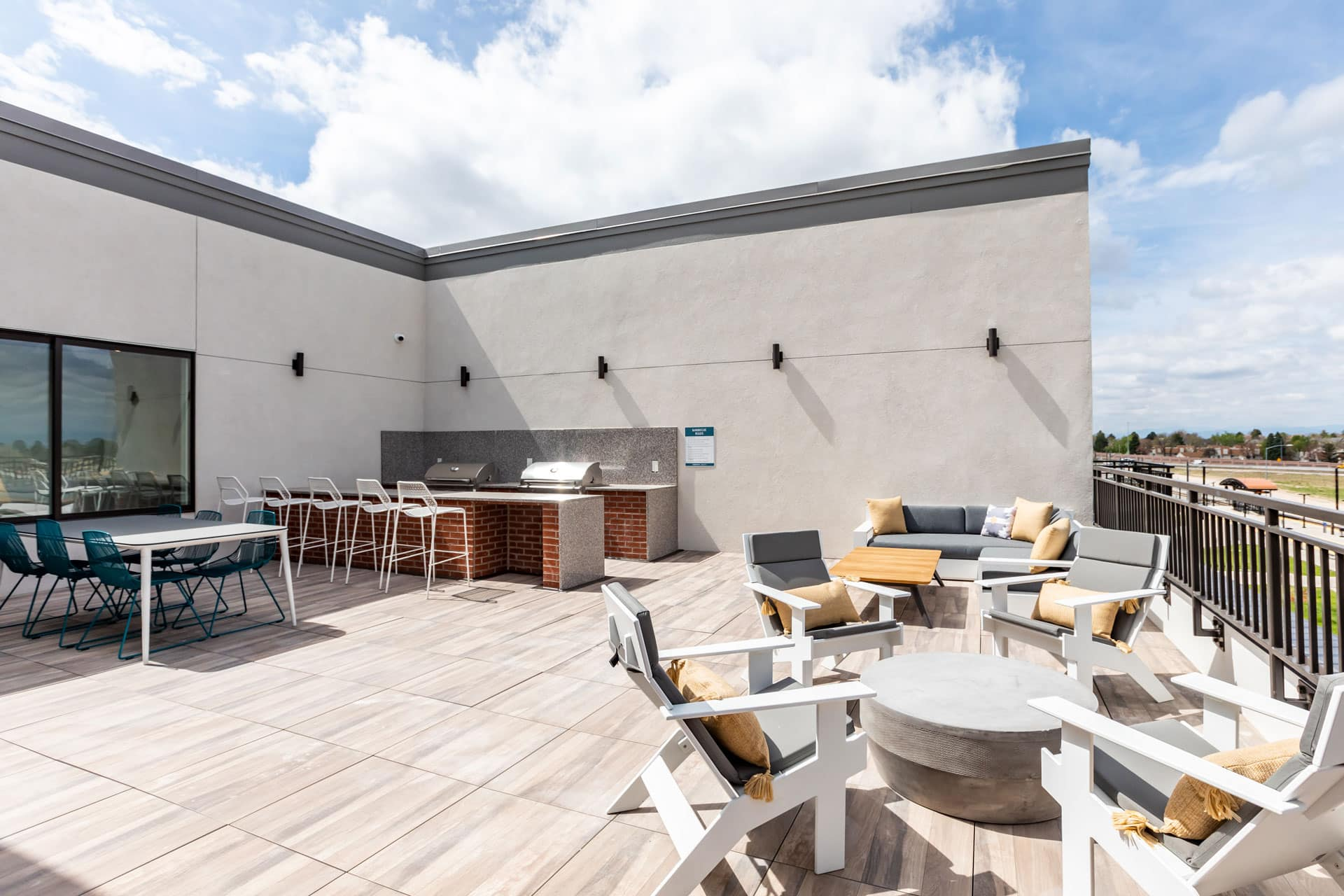 Sky Lounge with Outdoor Fireplace and BBQ Grills