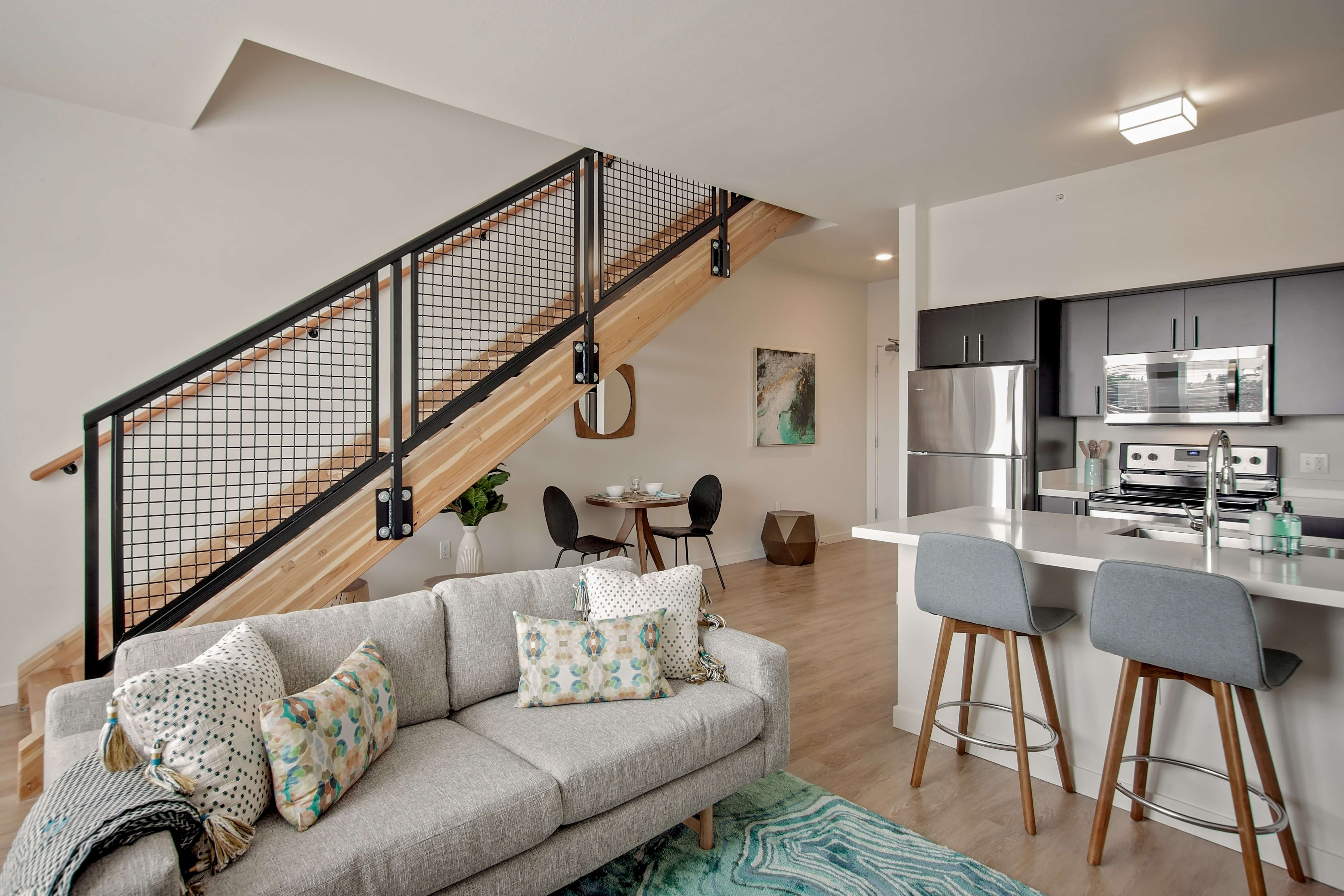 Modern studio, 1-, 2- and 3-bedroom apartments including townhome-style plans