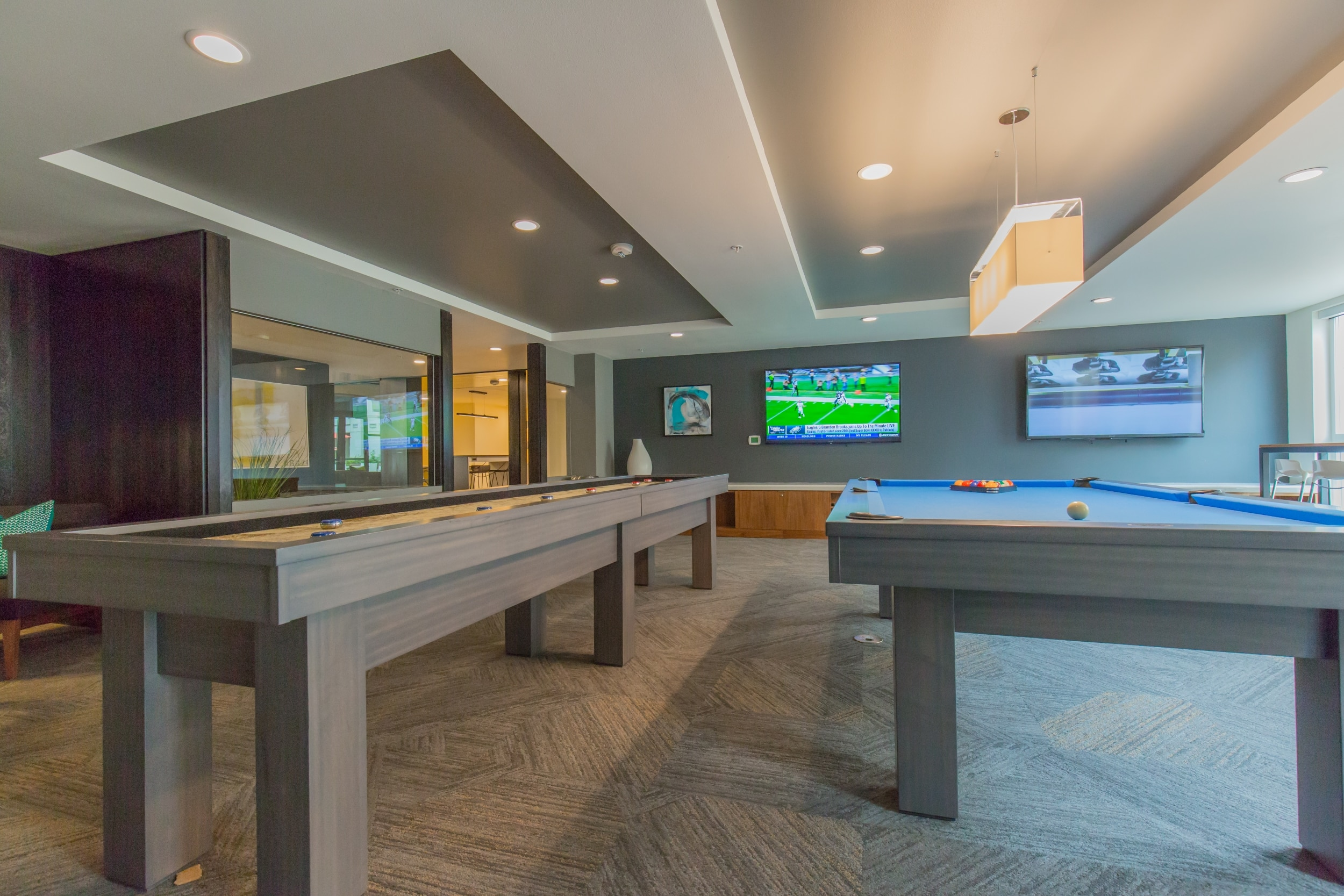Game Room with Billiards, Shuffle Board and Large Screen TVs